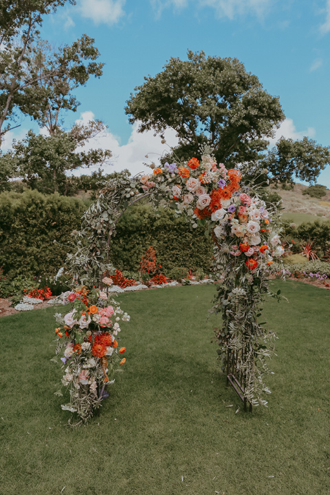 pink and orange floral ceremony arch
