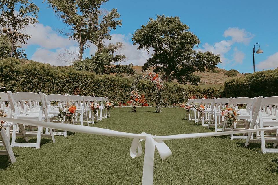ceremony décor with chairs and bright colored florals