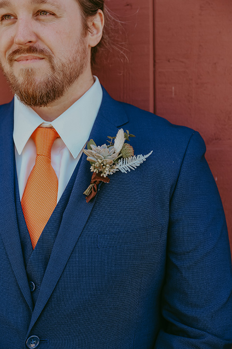 groom in a cobalt blue suit for purchase with a burnt orange tie