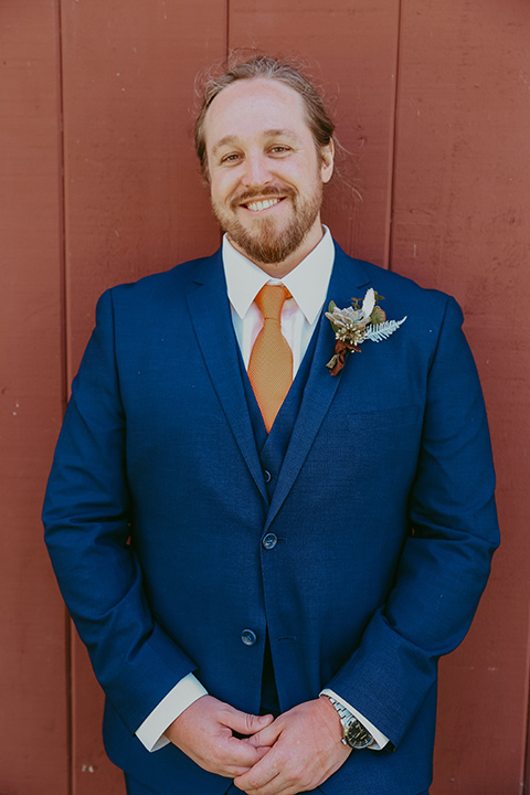 the groom in a cobalt blue suit for purchase with a burnt orange tie