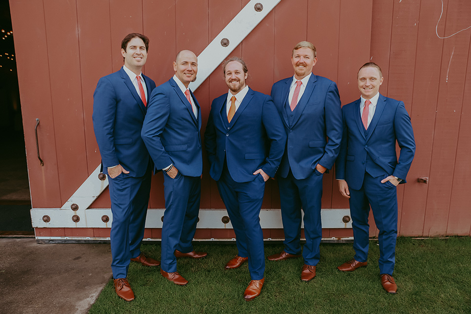 the groom in a cobalt blue suit for purchase and the groomsmen in rental cobalt suits