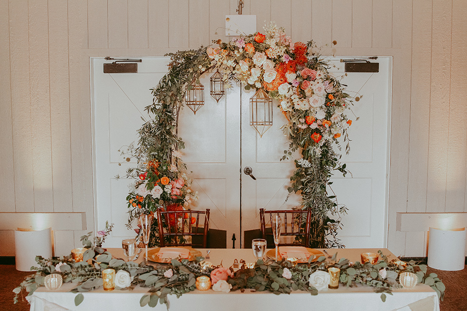 sweetheart table with wooden and floral decor