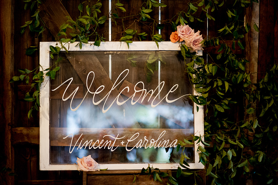 glass table number décor at reception
