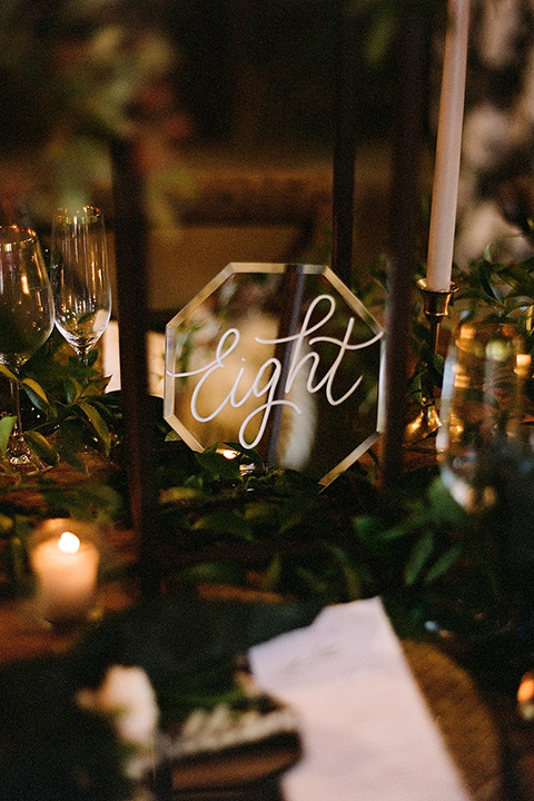 table numbers and décor on reception tables
