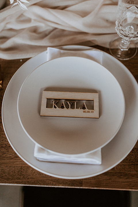 white flatware with wooden custom table cards