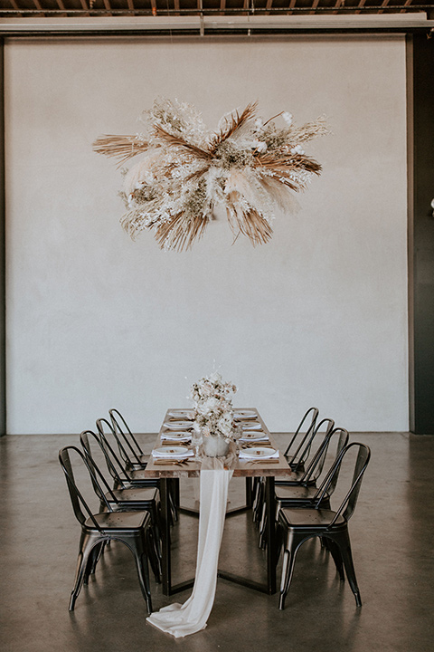 farmtable style chairs and table with white linens and bohemian details