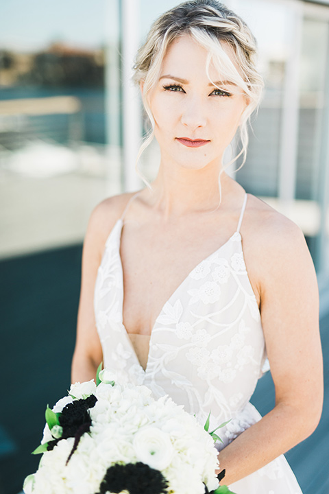 bride in a white gown with a deep v neckline and thin straps