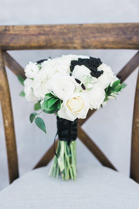 black and white flowers with a black ribbon