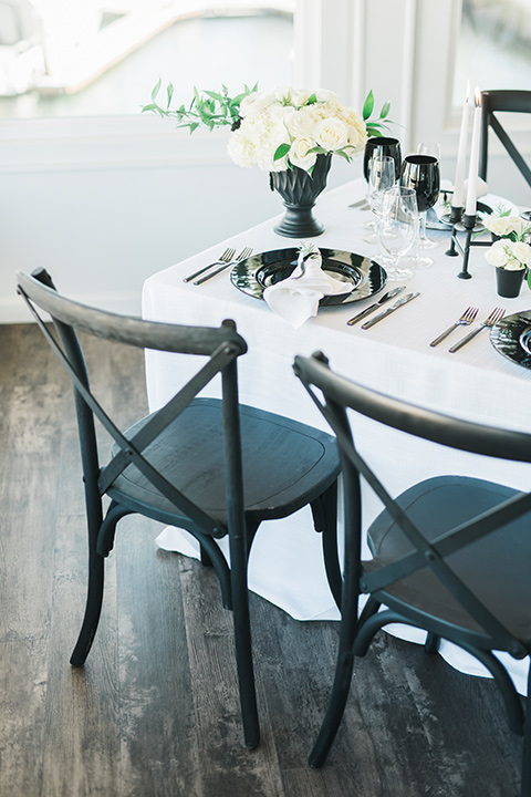 white table linens with black farmhouse style chairs
