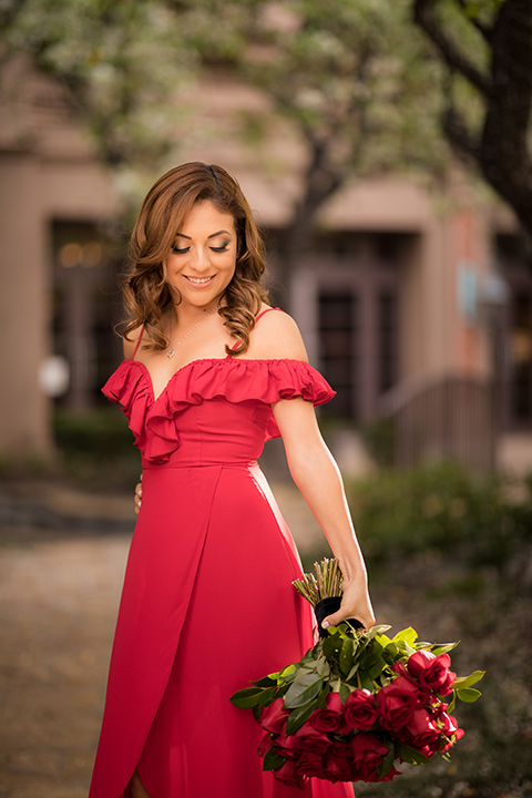 girl in a long red dress with an off the shoulder detail