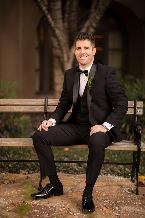 man in a black tuxedo with a shawl lapel tuxedo