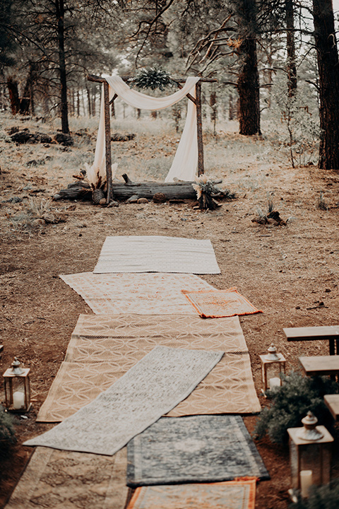 ceremony décor with bohemian rugs and pampas grass
