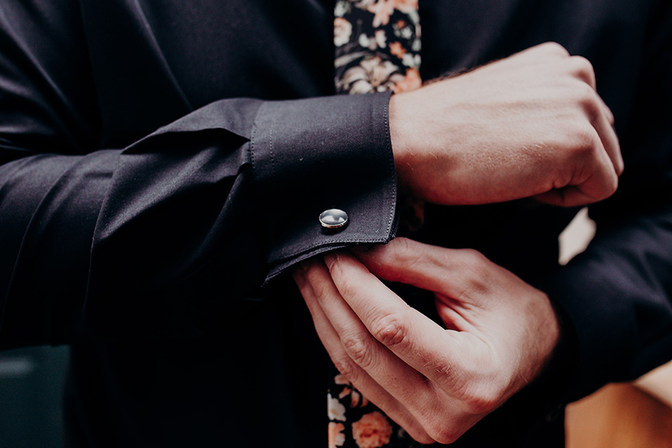 groom fixing his sleeve cufflink