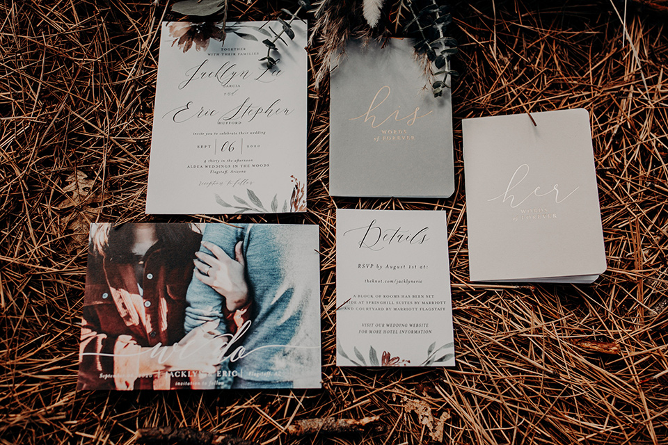 invitations with pastel forest detail