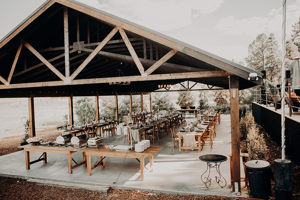 wedding reception under an outdoor gazebo with bohemian details