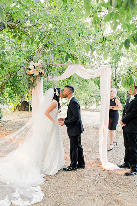 ride in a white ballgown with a plunging neckline and long veil