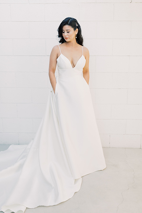 bride in a white modern ballgown with pockets and a low cut neckline