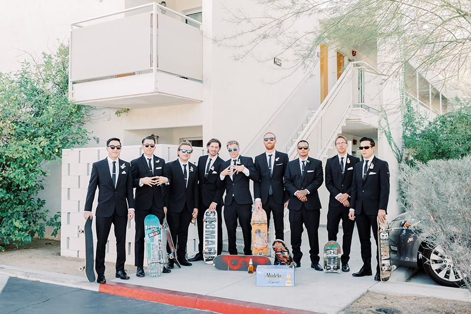 groom and groomsmen in black tuxedos and black bow ties