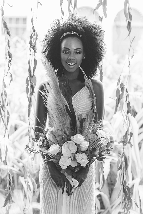 bride in a white lace formfitting gown with a V-neckline