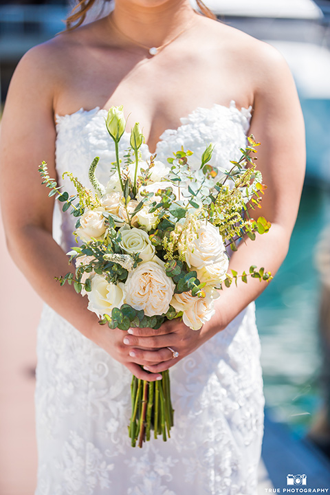 bridal bouquet with white roses and yellow flowers