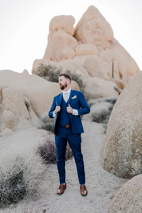 groom in a cobalt blue suit and a neutral colored long tie