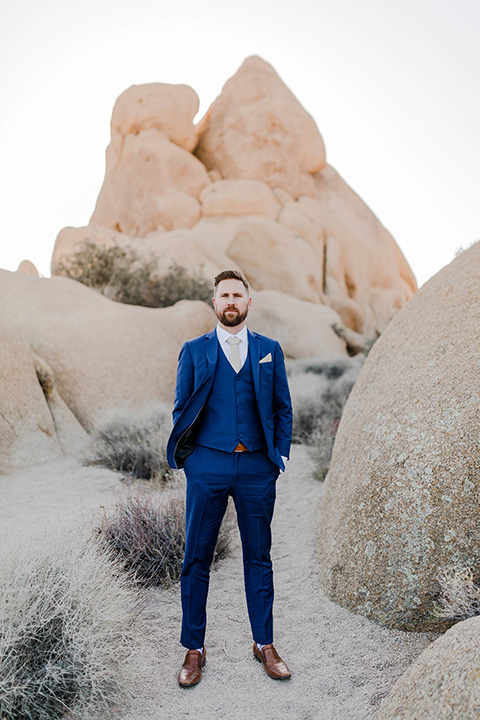 groom in a cobalt blue suit with a neutral long tie