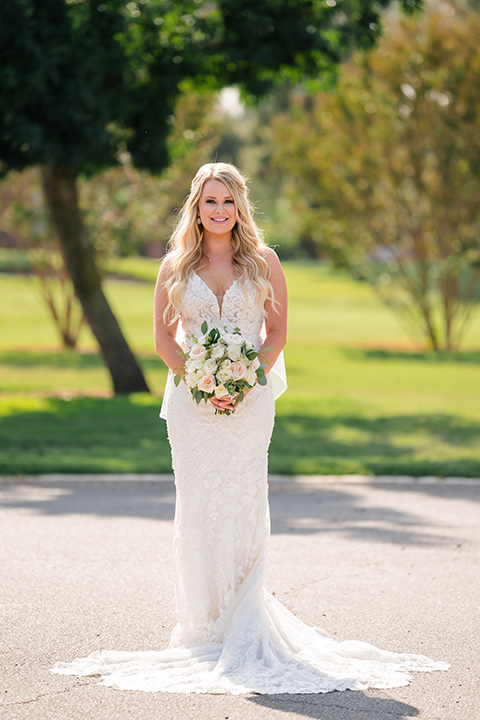 bride in a formfitting gown with thin straps and lace details