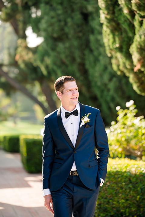the groom in a navy tuxedo