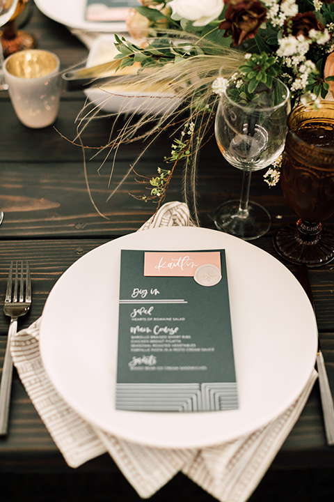 white linens with green table menus