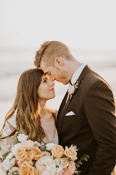 bride in a flowing ballgown and the groom in a black suit