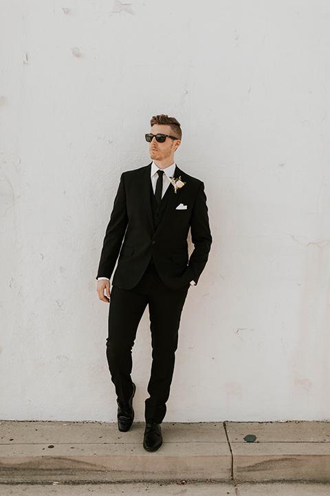 groom in a black suit