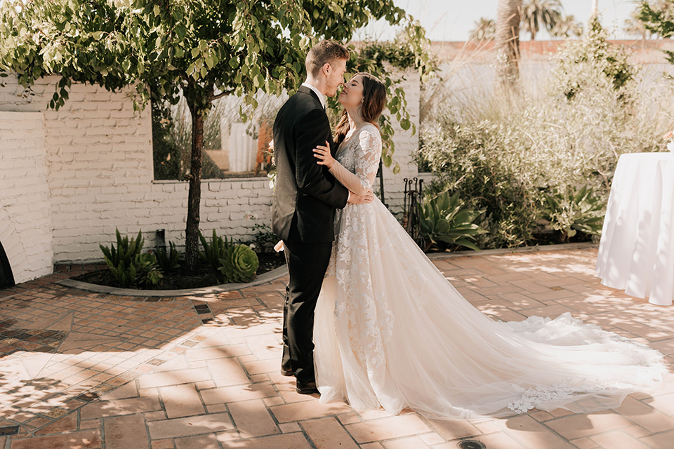 bride in a flowing ballgown and the groom in a black suit,