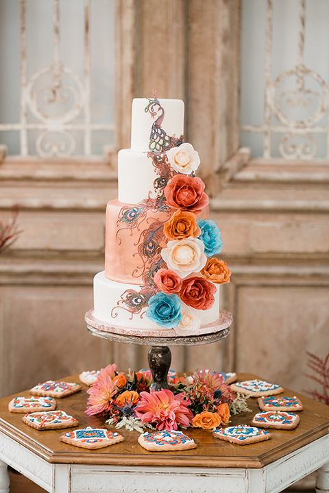 white cake with blue and orange floral details
