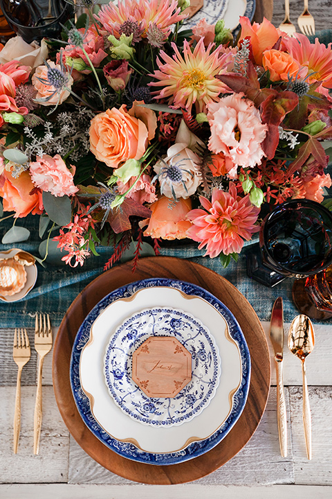 Spanish inspired flatware with orange and pink florals and gold touches