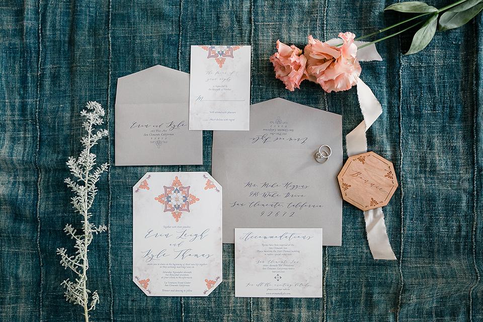grey and white colored invitations