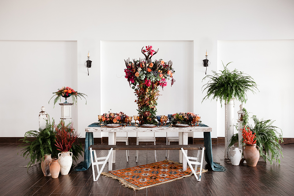table with white linens and gold flatware