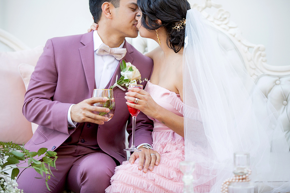 bride in a pink ballgown with ruffles and strapless neckline