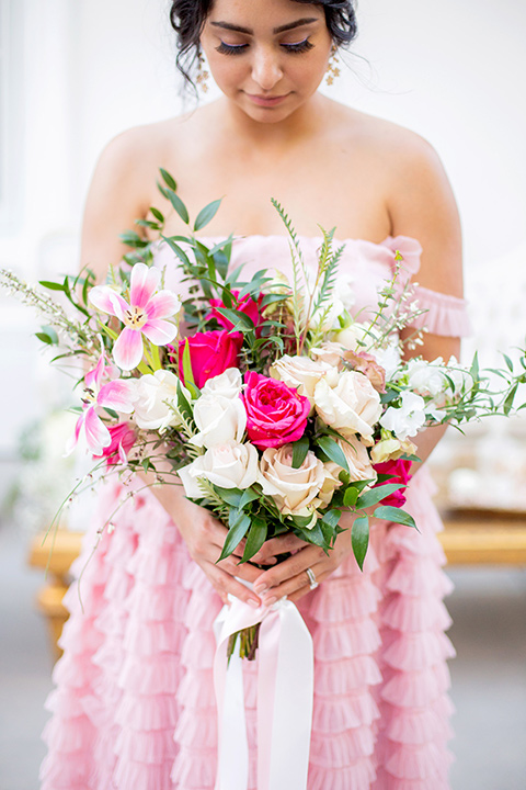 bride in a pink ballgown with ruffles