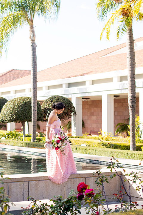 bride in a pink gown with ruffles