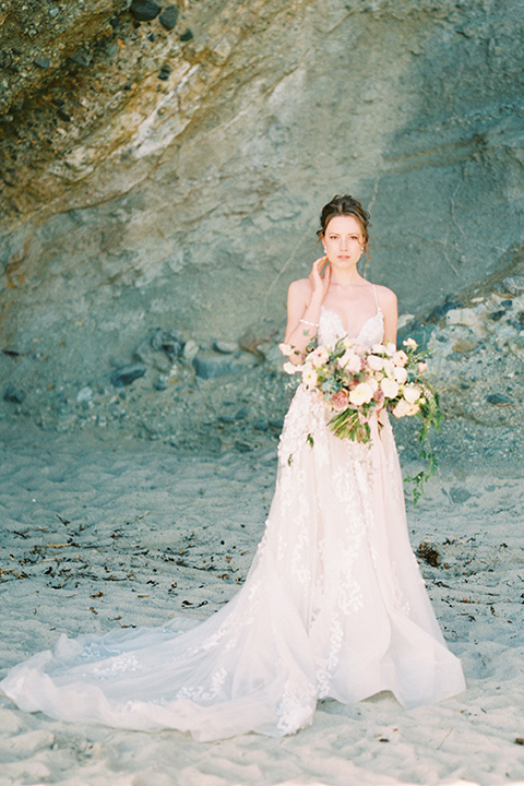 bride in a lace gown with a flowing tulle skirt and thin straps