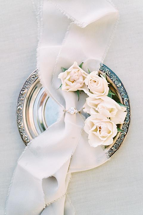white rose flower arrangement and silk ribbon
