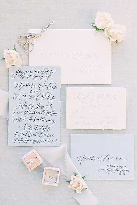white and pale blue invitaions