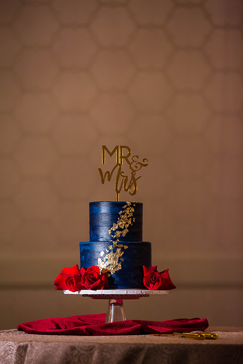 navy cake with gold and red decor