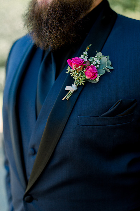 navy blue tuxedo with a black shirt and bow tie