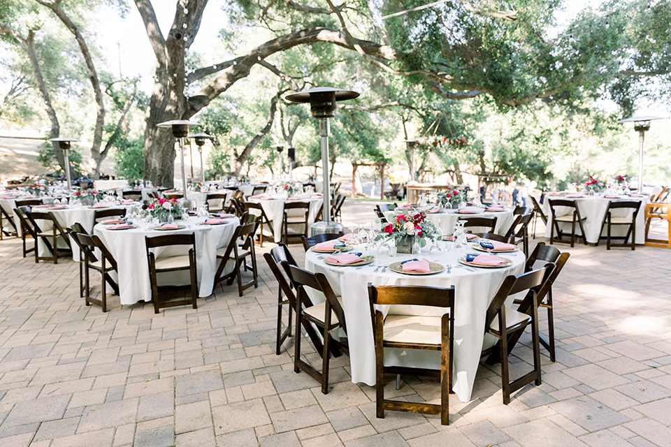 reception with wooden chairs and white linen tables