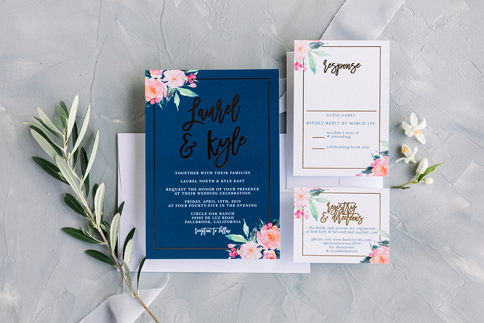 white and navy invitations with pink flowers