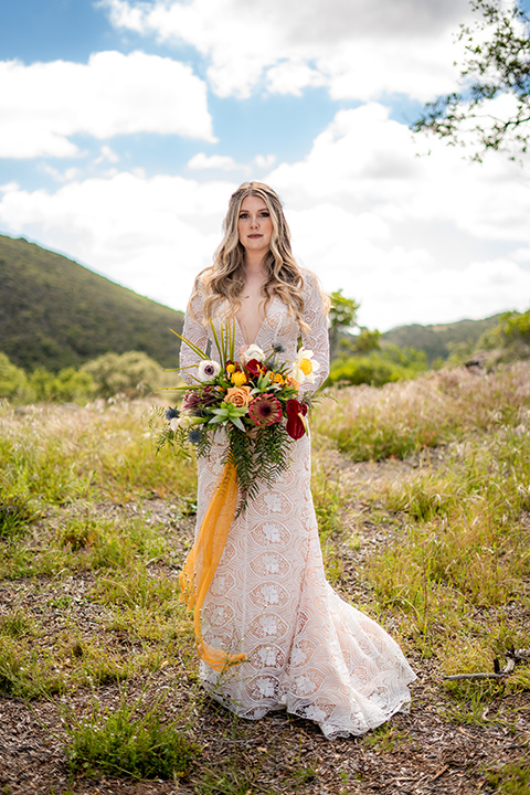 bride in a lace gown with long sleeves