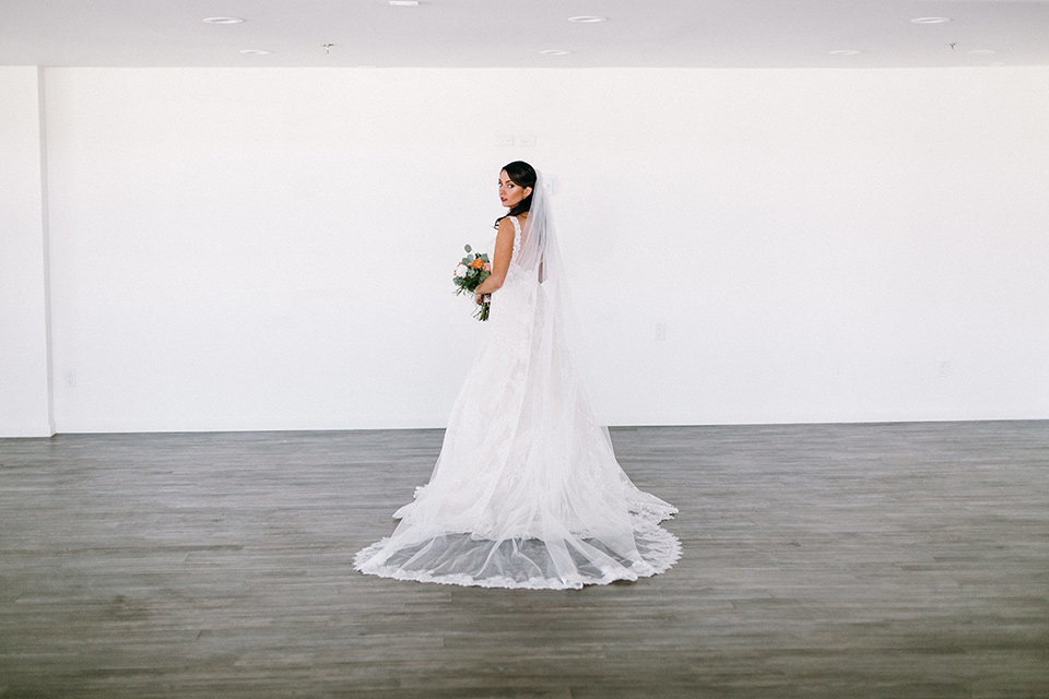 bride in a lace white gown with a long veil