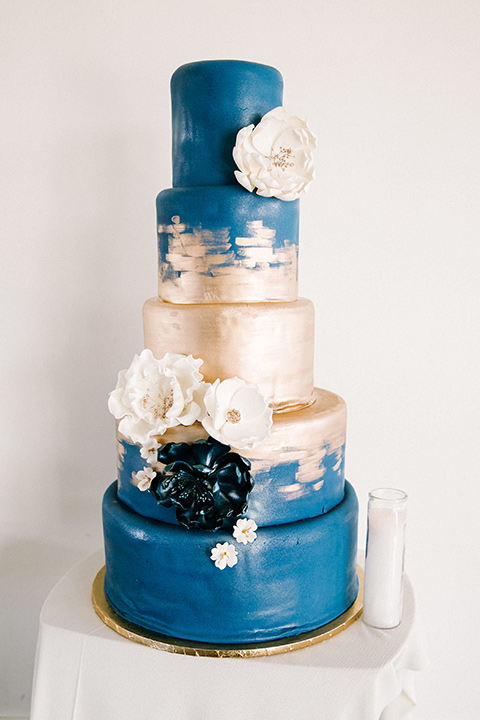 white and blue cake with gold detailing