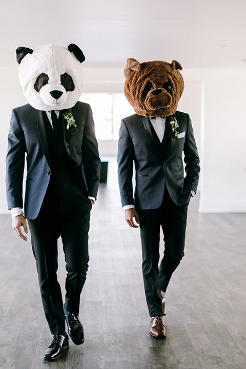 groomsmen in a navy shawl lapel tuxedo with black bow ties and white pocketsquare wearing animal heads
